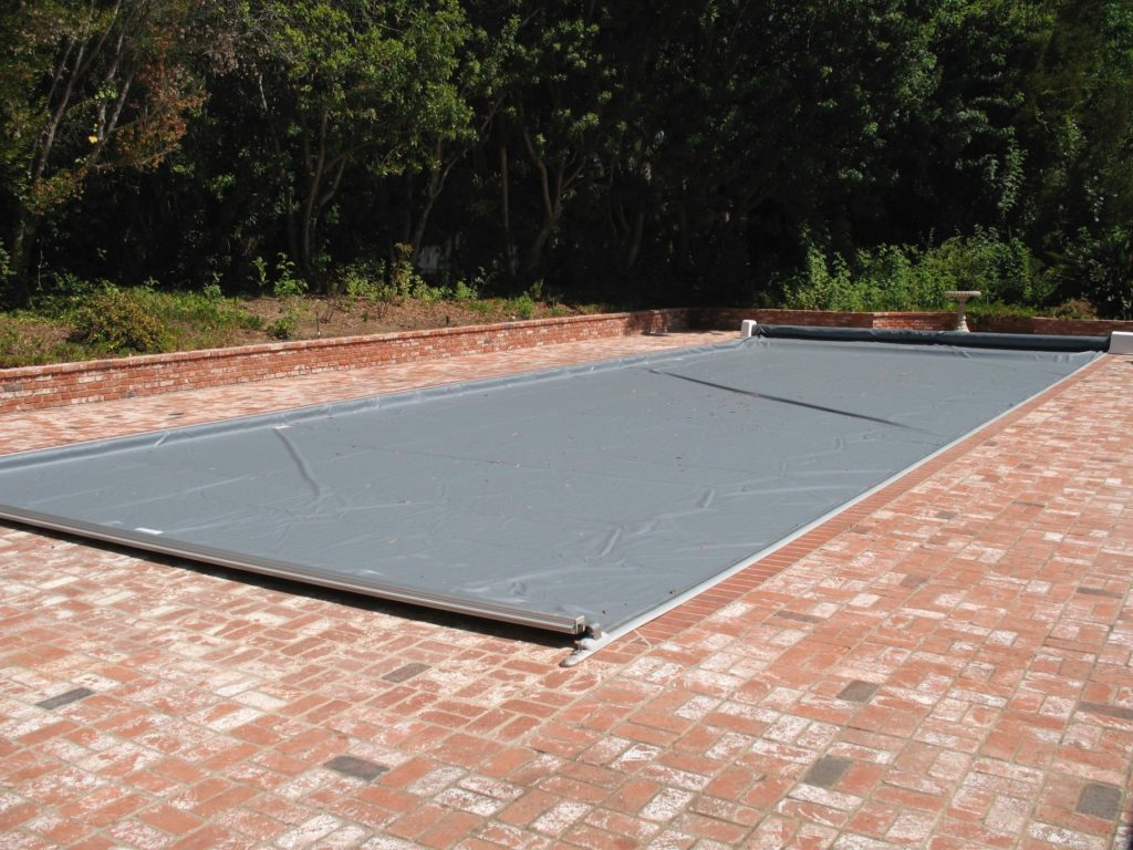 Deckmount automatic pool safety cover installed by Poolsafe in Santa Fe New Mexico