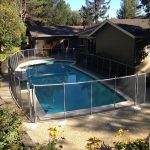 Removable mesh pool fence installed by Poolsafe